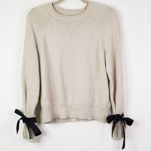 Tan beige crewneck sweater with black ribbon tie